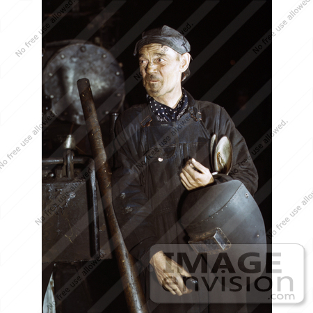 #19158 Photo of a Male Welder in Coveralls, Holding a Helmet, 1942 by JVPD