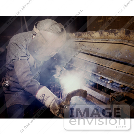 Royalty free industrial stock photo of a welder making boilers for a