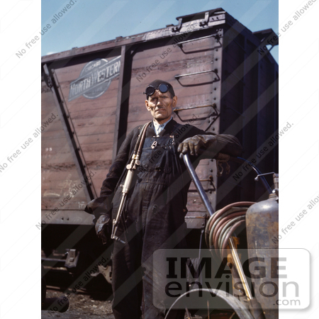 #19166 Photo of a Male Welder Standing by a Railroad Car by JVPD