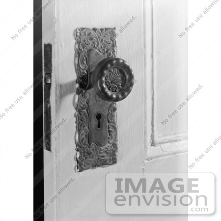 Stock Photo Door Knob and Skeleton Key Hole on a Door at the