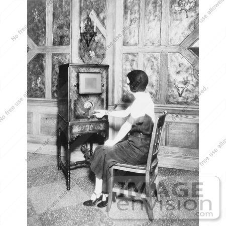 #20803 Stock Photography of a Woman Sitting in a Chair and Tuning a Radio by JVPD