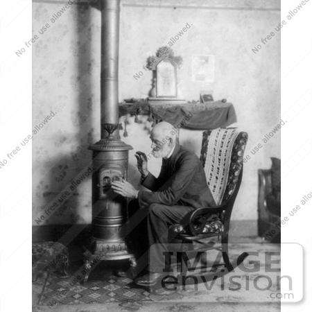 #20883 Stock Photography of an Old Man in a Rocking Chair, Cuddling up to a Stove to Keep Warm by JVPD