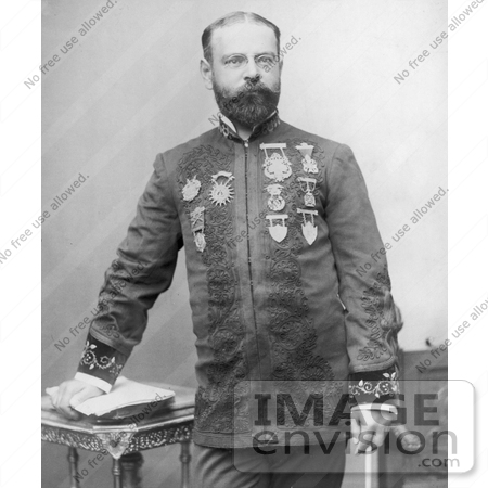 #21297 Stock Photography of John Philip Sousa Resting His Hand on a Stack of Papers on a Table by JVPD
