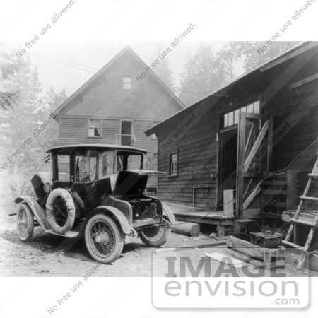 21615 Historical Stock Photo Of A Detroit Electric Automobile Parked By Building An