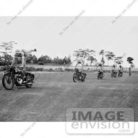 #21692 Stock Photography of Women Performing Stunts on Motorcycles by JVPD