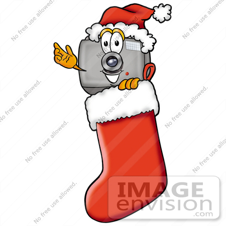 #23174 Clip Art Graphic of a Flash Camera Cartoon Character Wearing a Santa Hat Inside a Red Christmas Stocking by toons4biz