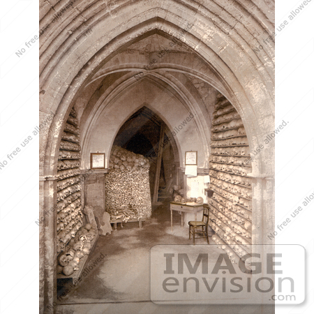 #26777 Stock Photography of Human Skulls and Skeletal Remains Stacked in the Ossuary Bone Store of the Church Crypt in Hythe Kent England by JVPD