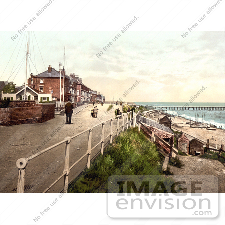 #26877 Stock Photography of People Walking On The Parade Promenade Near The Coast Guard Station In Southwell England by JVPD