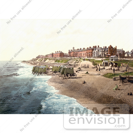 #26901 Stock Photography of People Near Boats And Bathing Machines On The Beach In Southwell England by JVPD