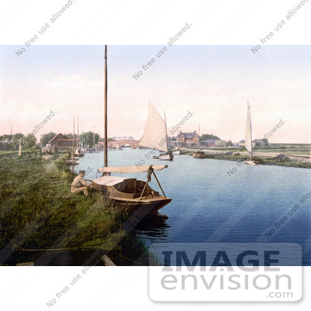 #26908 Stock Photography of A Man Sitting By A Boat On The River Thurne Near The Medieval Bridge In Potter Heigham Norfolk East Anglia England by JVPD