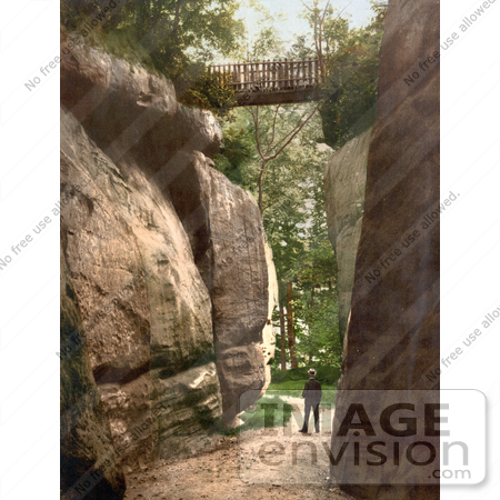 #26916 Stock Photography of a Man Standing Under a Footbridge Between Rocks at the High Rocks in Tunbridge Wells Kent England UK by JVPD