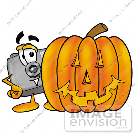 #28016 Clip Art Graphic of a Flash Camera Cartoon Character With a Carved Halloween Pumpkin by toons4biz
