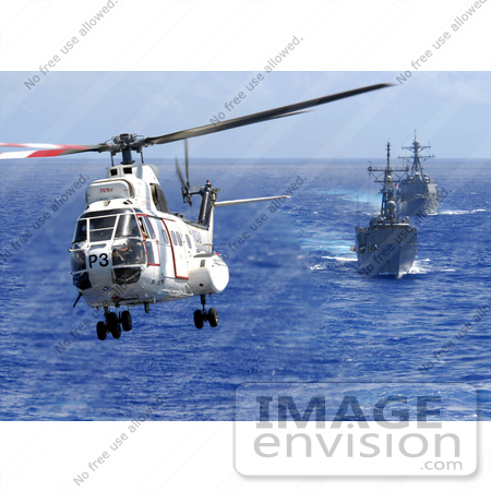 #30642 Stock Photo of an AS-332 Super Puma Helicopter Passing Above a Destroyer and Firgate by JVPD