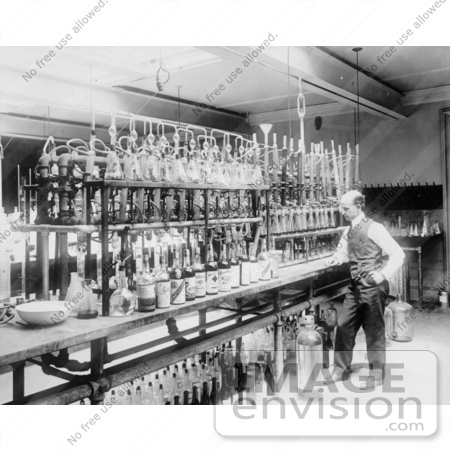 #33678 Stock Photo of a Man, A Chemical Laborator, Standing At A Counter in Front of a Line of Bottles, Testing Whiskey by JVPD