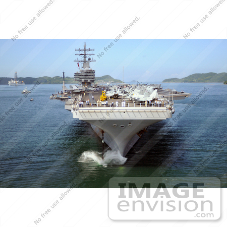 #35244 Stock Photo of The Nimitz-Class Aircraft Carrier USS Ronald Reagan (CVN 76) Dropping Anchor In Sasebo Harbor In Sasebo, Japan For A Port Call by JVPD