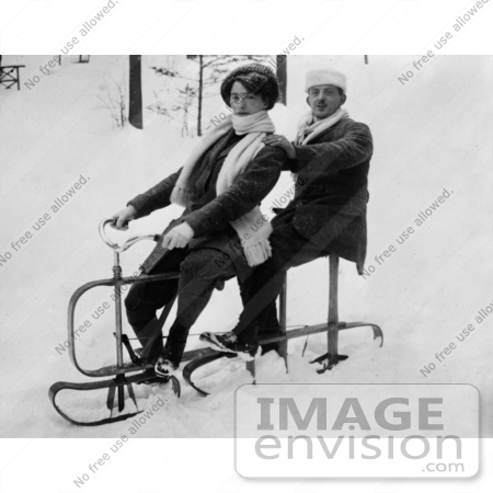 #35669 Stock Photo Of A German Couple Riding A Tandem Sled In The Snow by JVPD