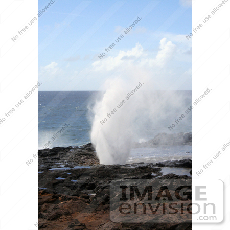 #36534 Stock Photo of The Spouting Horn Blowhole Praying Water By The Pacific Ocean, Poipu, Kauai, Hawaii by Jamie Voetsch