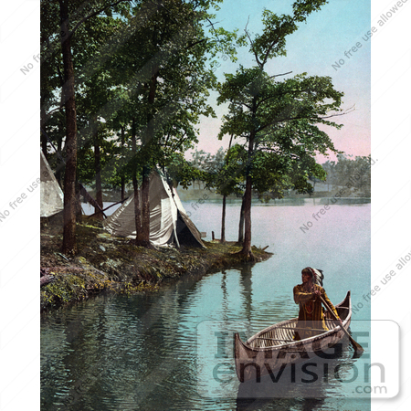 #40870 Stock Photo Of A Native American Indian Man Paddling Past Tipis In A Boat by JVPD