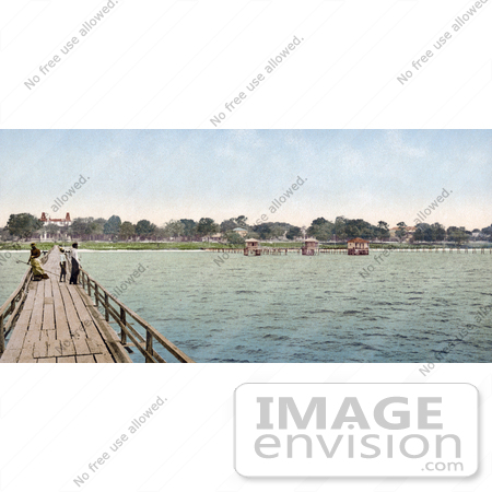 #41055 Stock Photo Of People Taking A Leisurely Stroll On A Bridge At The Mexican Gulf Hotel In Pass Christian, Mississippi by JVPD