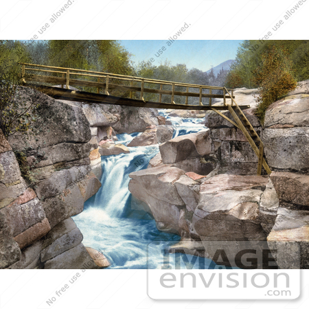 #41112 Stock Photo Of A Footbridge Over The Upper Falls Of The Ammonoosuc River In The White Mountains Of New Hampsire by JVPD
