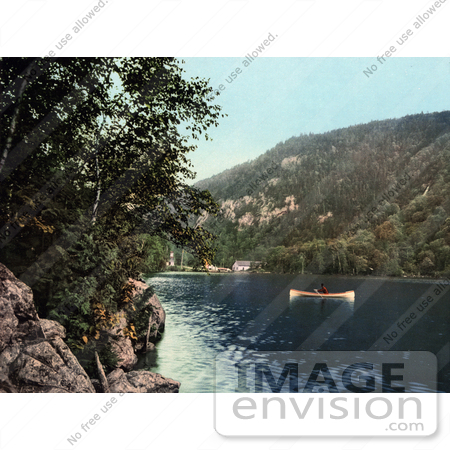 #41131 Stock Photo Of A Lone Person Canoeing On Upper Cascade Lake In The Adirondack Mountains Of New York by JVPD