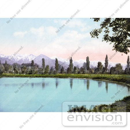 #41134 Stock Photo Of Trees Along The Water At Liberty Park, With Views Of The Wasatch Range Mountains, Salt Lake City, Utah by JVPD