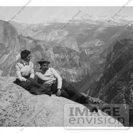 #41172 Stock Photo Of A Couple Relaxing On A Rock Cliff With A View Of The Cap Of Liberty, Nevada Falls And The Sierras From Eagle Peak, Yosemite National Park, California by JVPD
