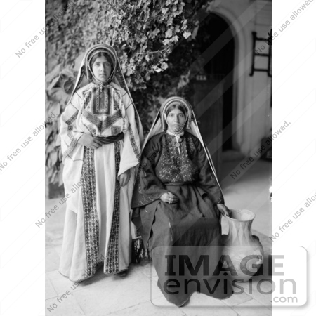 #43451 RF Stock Photo Of Two Young Ramallah Women In Black And White, One Sitting, One Standing by JVPD