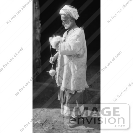 #43459 RF Stock Photo Of A Black And White Ramallah Peasant Man Spinning Wool by JVPD