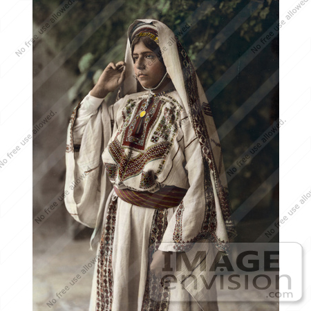 #43468 RF Stock Photo Of A Ramallah Woman Standing In A Traditional Dress by JVPD