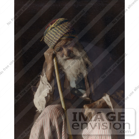 #43477 RF Stock Photo Of A Tired Senior Arab Man Sitting And Leaning Against His Cane, Yemen by JVPD