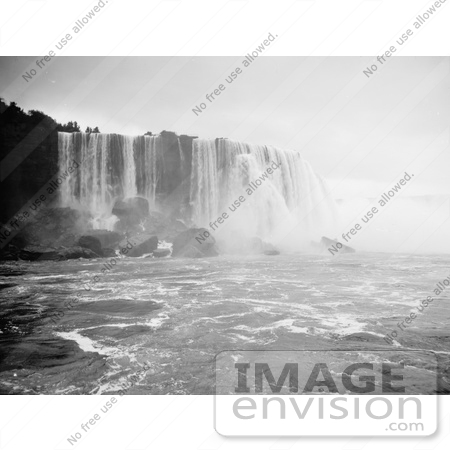 #48810 Royalty-Free Stock Photo Of A Scene Of Horseshoe Falls, Niagara Falls Rushing Down Over Boulders by JVPD