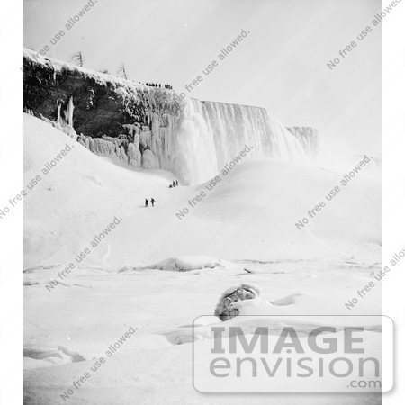 #48821 Royalty-Free Stock Photo Of People Walking Through The Snow Towards An Icy Mountain At Niagara Falls In Winter by JVPD