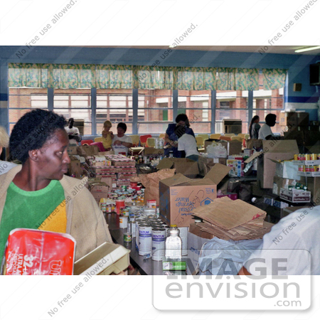 #5066 Stock Photography of Disaster Relief Volunteers Organizing Food for the Victims of Hurricane Hugo by JVPD