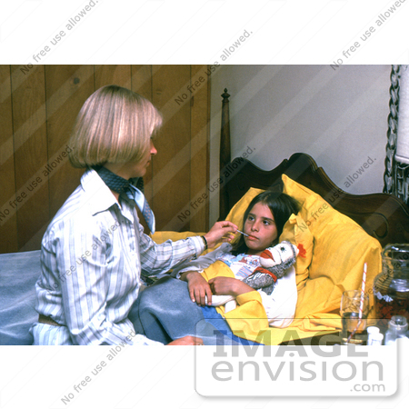 #5216 Stock Photography of a Mother Caring for Her Child who is in Bed Sick with a Cold by JVPD