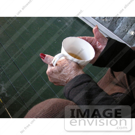 #53825 Royalty-Free Stock Photo of a senior woman's hands holding a tea cup by Maria Bell