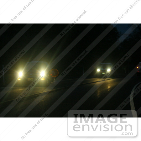 #603 Picture of Bright Car Lights at Night by Kenny Adams