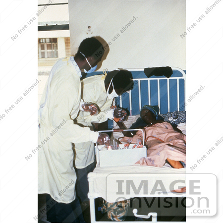 #6294 Picture of a Doctors Giving Health Care to a Female Lassa Fever Patient in the Segbwema, Sierra Leone Clinic by KAPD