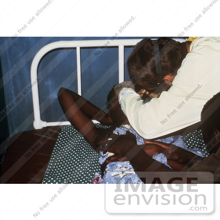 #6301 Picture of a Doctor Getting a Eye Scraping from a Lassa Fever Patient by KAPD