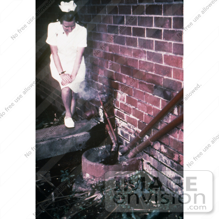 #6307 Picture of a Nurse Standing Near Sewage Pipes Outside of an Infectious Disease Hospital in Johannesburg, South Africa by KAPD