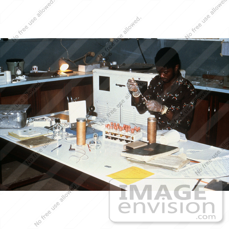 #6442 Picture of a Person Separating Blood Sera at the Segbwema, Sierra Leone Lassa Fever Laboratory In 1977 by KAPD