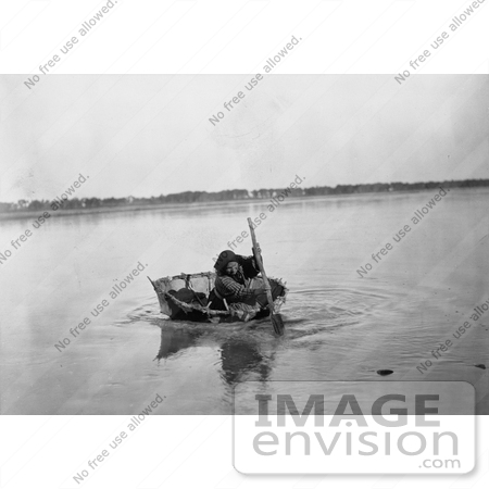 #7035 Stock Photograph of a Mandan Indian Rowing a Bull Boat by JVPD