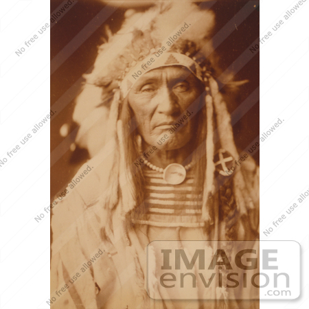 Stock image of an apsaroke indian man called young hairy wolf, wearing
