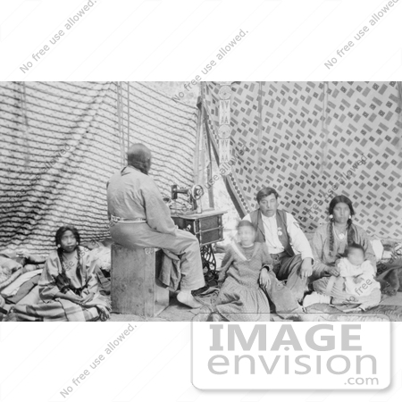 #7107 Stock Photography: Crow Indian Woman Sewing in a Tipi by JVPD