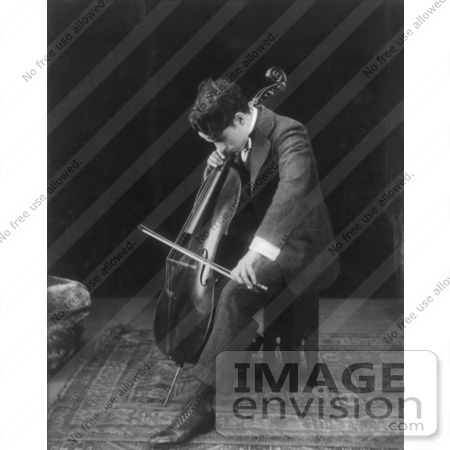 #7350 Black and White Stock Photograph of Charlie Chaplin Seated and Playing a Cello by JVPD