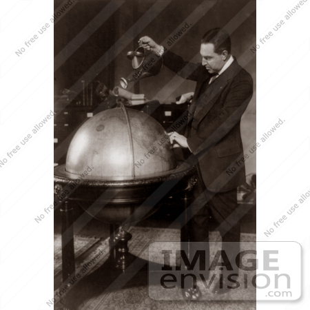 #7450 Stock Photograph of John Phillip Hill Pouring Water on Globe, Prohibition by JVPD