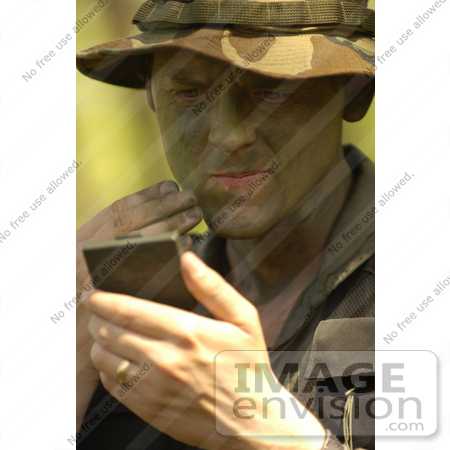 #8868 Picture of a Soldier Applying Camouflage Paint by JVPD