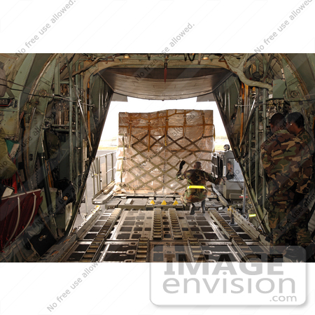 #8894 Picture of a Soldier Loading a C-130 Aircraft by JVPD