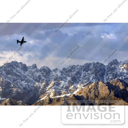 #8996 Picture of a C-130 Hercules by Mountains by JVPD