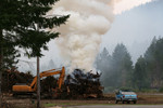 Free Picture of Controlled Fire Beside a Tractor and Truck